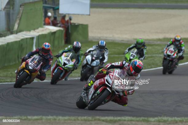 Lorenzo Savadori of Italy and Milwaukee Aprilia leads the field during the Race 1 during the FIM Superbike World Championship Race 1 at Enzo and Dino...