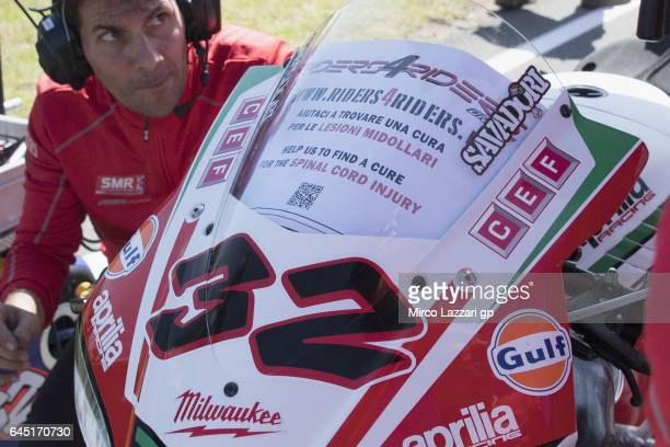 Lorenzo Savadori of Italy and Milwaukee Aprilia supports the help for the riders on the grid during the Race 1 during round one of the FIM World...