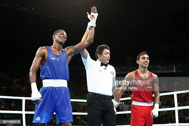 Lorenzo Sotomayor Collazo of Azerbaijan reacts after defeating Artem Harutyunyan of Germany in the Men's Light Welter 64kg Semifinal 2 on Day 14 of...