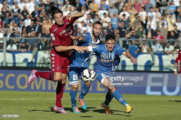 Lorenzo Tonelli and Mario Rui of Empoli FC battles for the ball with Alibin Ekdal of Cagliari Calcio during the Serie A match between Empoli FC and...