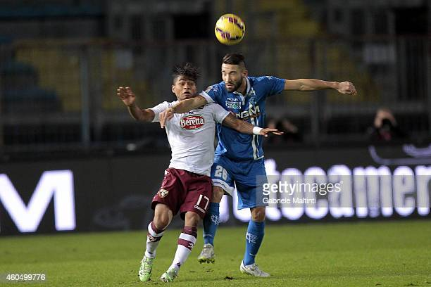Lorenzo Tonelli of Empoli FC battles for the ball with Alexander Martinez of Torino FC during the Serie A match between Empoli FC and Torino FC at...
