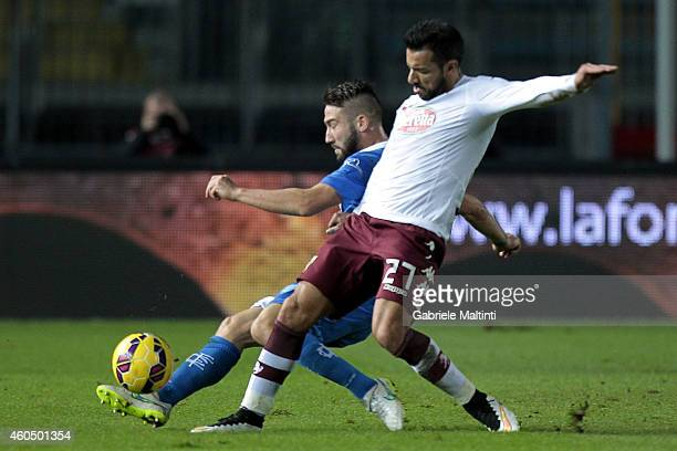 Lorenzo Tonelli of Empoli FC battles for the ball with Fabio Quagliarella of Torino FC during the Serie A match between Empoli FC and Torino FC at...