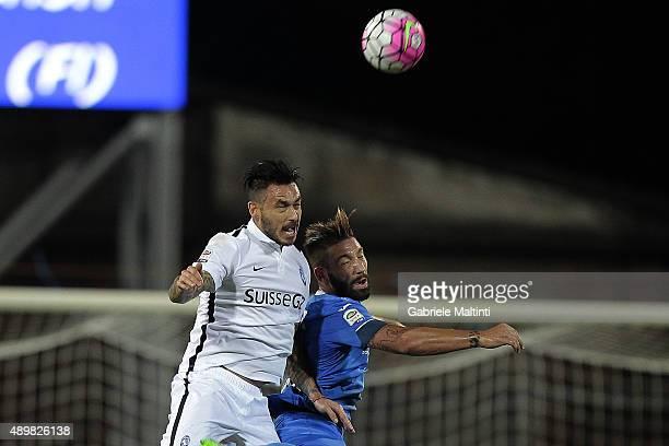 Lorenzo Tonelli of Empoli FC battles for the ball with Mauricio Pinilla of AC Atalanta BC during the Serie A match between Empoli FC and Atalanta BC...