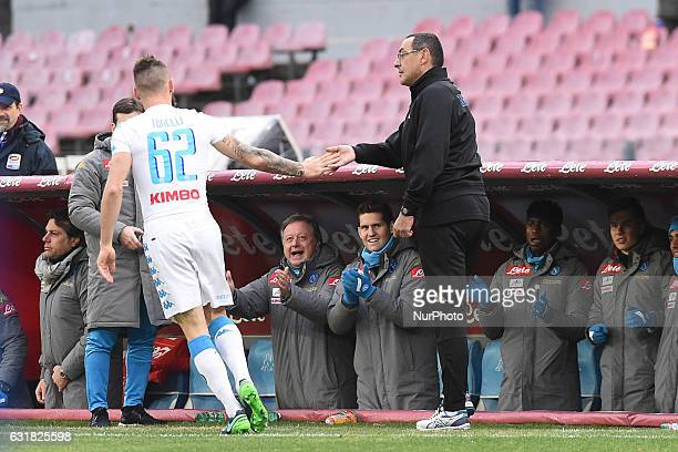 Lorenzo Tonelli of SSC Napoli celebrates after scoring with Maurizio Sarri during the Serie A TIM match between SSC Napoli and Pescara Calcio at...