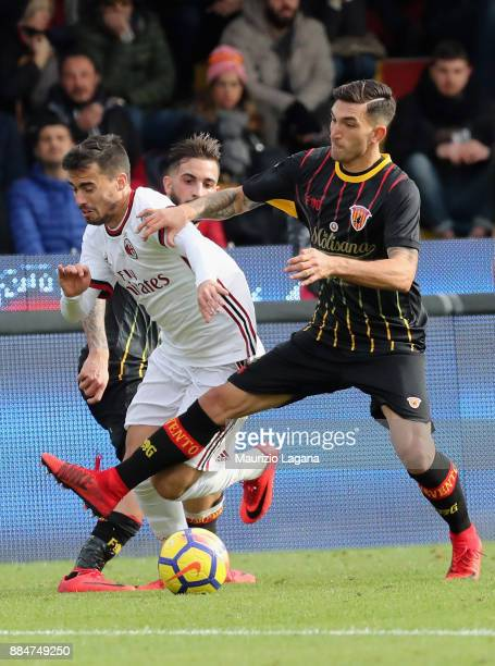 Lorenzo Venuti of Benevento competes for the ball with Suso of Milan during the Serie A match between Benevento Calcio and AC Milan at Stadio Ciro...
