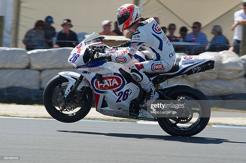 Lorenzo Zanetti of Italy and Pata Honda World Superbike lifts the front wheel during the qualifying during the round first of 2013 Supersport FIM World Championship at Phillip Island Grand Prix Circuit on February 23, 2013 in Phillip Island, Australia.