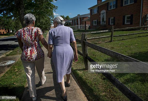 Loretta Veney on a walk with her mother Doris Woodward who has dementia in Ft Washington MD on June 29 2016 Loretta has an approach that is different...