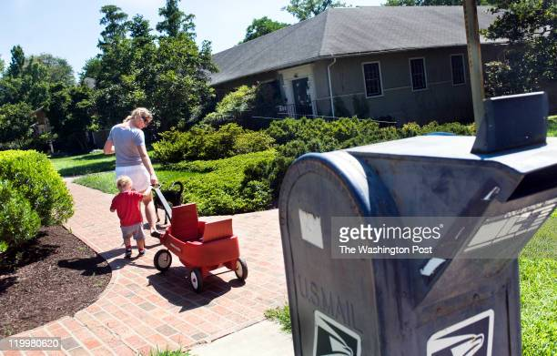 CHASE MD JULY 26 Lori and Joshua Weinstein pass by the Chevy Chase MD post office on July 26 2011 in Chevy Chase md