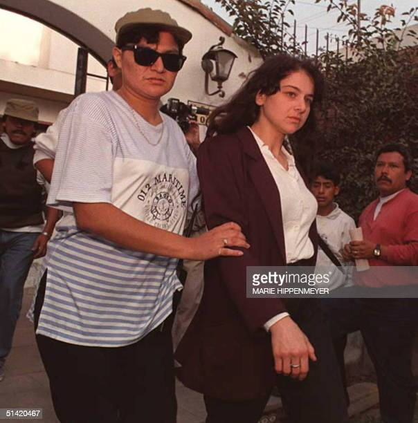 Lori Berenson and of the US is escorted 15 December by a police woman 15 December out of the residence she allegedly rented for the Marxist...