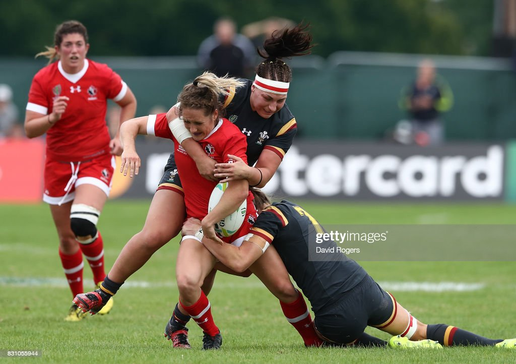 Lori Josephson of Canada is tackled by Amy Evans (L) and Rachel Taylor (R) of Wales during the Women's Rugby World Cup 2017 match between Canada and Wales on August 13, 2017 in Dublin, Ireland.