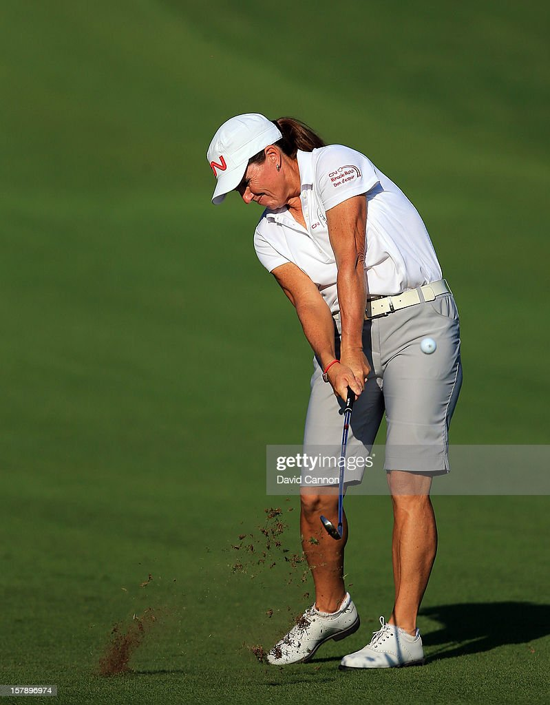 Lori Kane of Canada plays her second shot at the par 4, 14th hole during the third round of the 2012 Omega Dubai Ladies Masters on the Majilis Course at the Emirates Golf Club on December 7, 2012 in Dubai, United Arab Emirates.
