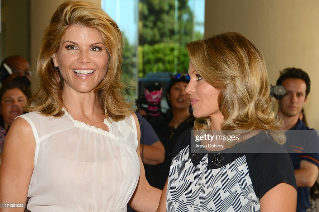 <a gi-track='captionPersonalityLinkClicked' href=/galleries/search?phrase=Lori+Loughlin&family=editorial&specificpeople=208147 ng-click='$event.stopPropagation()'>Lori Loughlin</a> and <a gi-track='captionPersonalityLinkClicked' href=/galleries/search?phrase=Candace+Cameron+Bure&family=editorial&specificpeople=699962 ng-click='$event.stopPropagation()'>Candace Cameron Bure</a> arrive at the Television Critic Association's Summer press tour - Hallmark Channel & Hallmark Movie Channel party at The Beverly Hilton Hotel on July 24, 2013 in Beverly Hills, California.