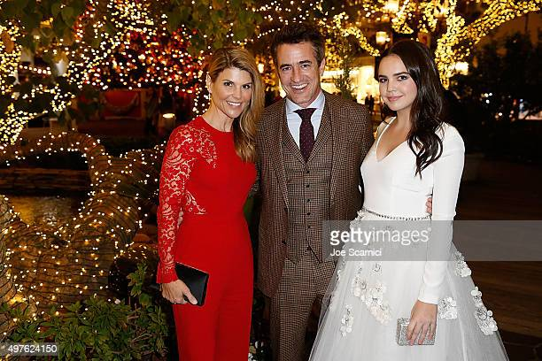 Lori Loughlin Dermot Murlroney and Bailee Madison pose for a photo prior to the World Premiere Screening of 'Northpole Open for Christmas' at The...