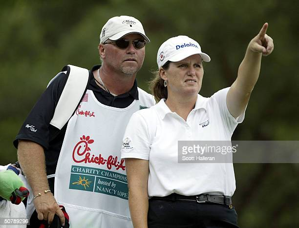 Lorie Kane of Canada looks over the the seventh tee with her caddie Danny Sharp during the second round of the ChickfilA Charity Championship at...