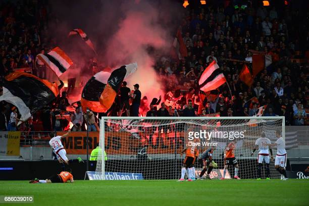 Lorient fans set off flares during the Ligue 1 match between FC Lorient and FC Girondins de Bordeaux at Stade du Moustoir on May 20 2017 in Lorient...