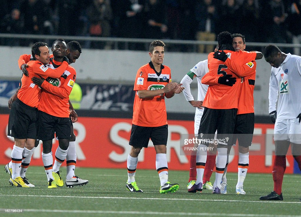 Lorient French forward Jeremie Aliadiere (R) is congratulated by teammates after scoring during the French Cup football match Lorient vs Brest, on February 27, 2013 at the Stadium of Moustoir in Lorient, western France.