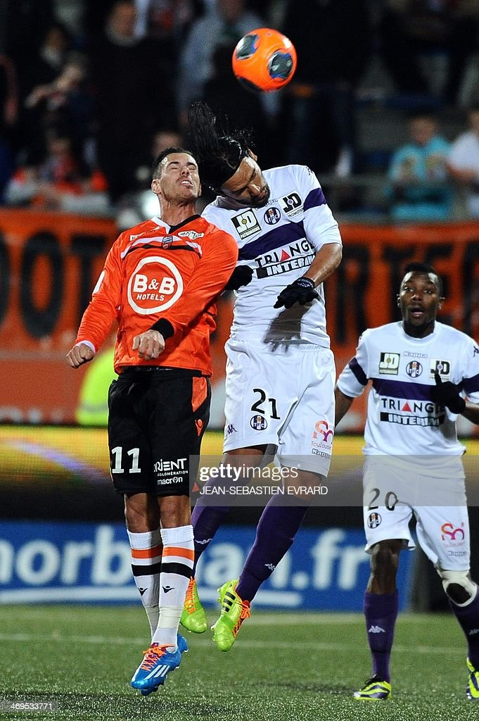 Lorient French forward Jeremie Aliadiere (L) vies with Toulouse's Colombia midfielder Abel Aguila during the French L1 football match between Lorient and Toulouse on February 15, 2014 at the Moustoir stadium in Lorient, western France. AFP PHOTO / JEAN-SEBASTIEN EVRARD