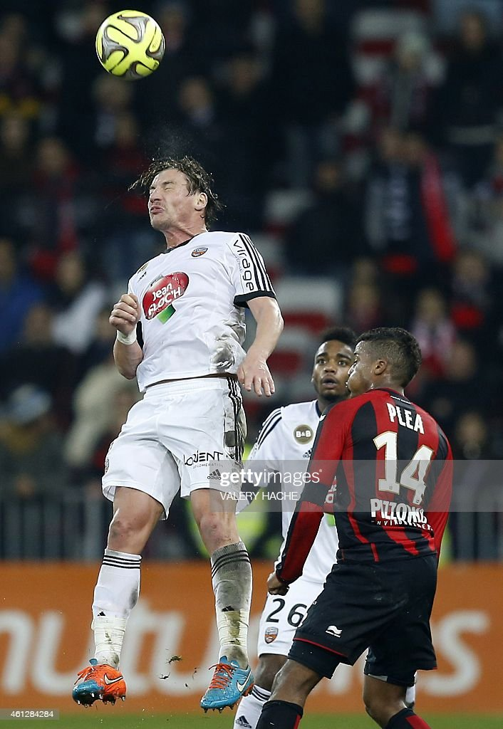 Lorient's Algerian midfielder <a gi-track='captionPersonalityLinkClicked' href=/galleries/search?phrase=Mehdi+Mostefa&family=editorial&specificpeople=6328029 ng-click='$event.stopPropagation()'>Mehdi Mostefa</a>-Sbaa (L) challenges Nice's French forward Alassa Plea (R) during the French L1 football match between Nice and Lorient at the Allianz Riviera stadium in Nice, southeastern France, on January 10, 2015.