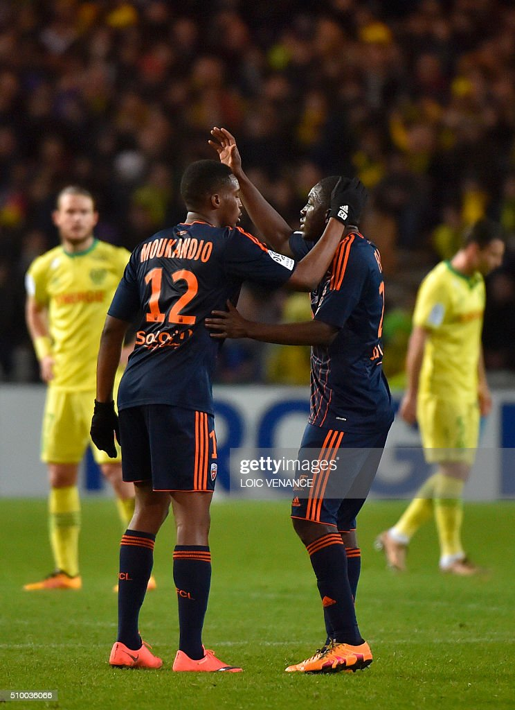 Lorient's Cameroonian forward Benjamin Moukandjo (L) celebrates after scoring a penalty kick during the French L1 football match between Nantes (FCN) and Lorient (FCL) at La Beaujoire Stadium in Nantes, western France, on February 13, 2016. AFP PHOTO / LOIC VENANCE / AFP / LOIC VENANCE