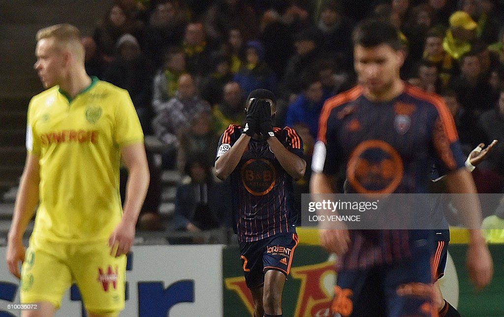 Lorient's Cameroonian forward Benjamin Moukandjo (C) celebrates after scoring a penalty kick during the French L1 football match between Nantes (FCN) and Lorient (FCL) at La Beaujoire Stadium in Nantes, western France, on February 13, 2016. AFP PHOTO / LOIC VENANCE / AFP / LOIC VENANCE