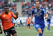 Lorient's Cameroonian forward Benjamin Moukandjo vies for the ball with Bastia's French defender Florian Marange during the French L1 football match...