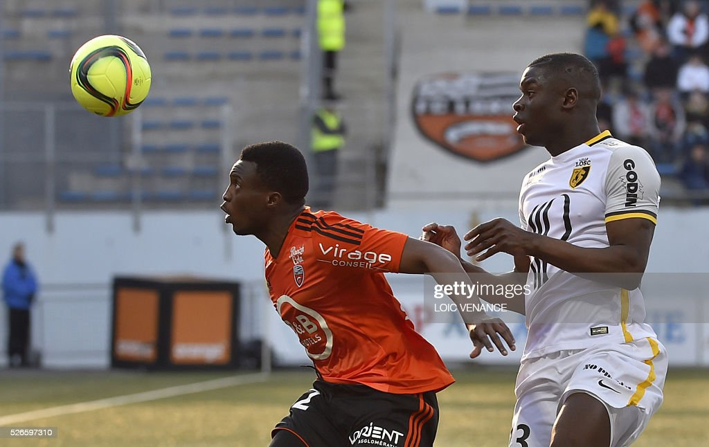 Lorient's Cameroonian forward Benjamin Moukandjo (L) vies with Lille's French defender Adama Soumaoro during the French L1 football match Lorient vs Lille at the Moustoir stadium in Lorient, western France, on April 30, 2016.