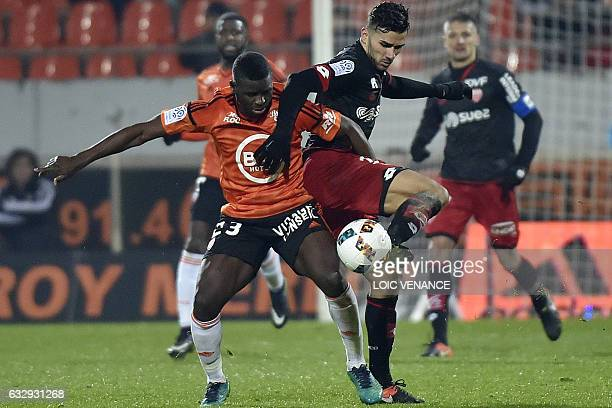 Lorient's defender Alhassan Wakaso vies with Dijon's FrenchAlgerian midfielder Mehdi Abeid during the French L1 football match between Lorient and...