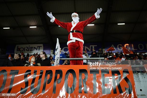 Lorient's fan dressed as Santa Claus cheers his team ahead of the French L1 football match between Lorient and Nantes on December 19 2015 at the...