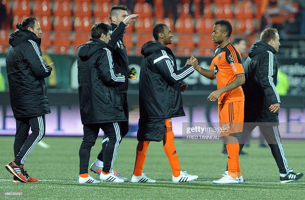 Lorientus forward jordan ayew shakes hands with teammates for Lorient match