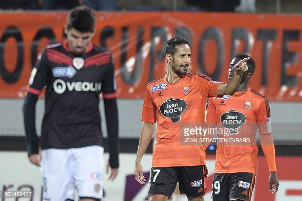 Lorient's French Algerian midfielder Walid Mesloub celebrates after scoring during the French League Cup football match between Lorient and Dijon on...