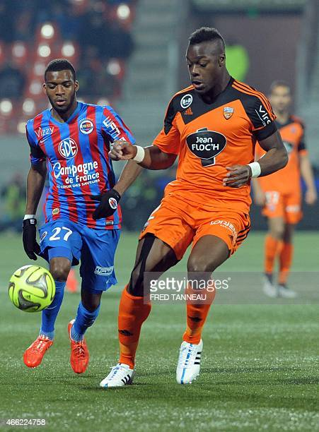 Lorient's French defender Kone Lamine vies with Caen's French midfielder Thomas Lemar during the French L1 football match Lorient versus Caen on...