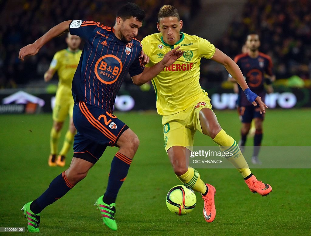 Lorient's French defender Lindsay Rose (L) vies with Nantes' French forward Yacine Bammou during the French L1 football match between Nantes (FCN) and Lorient (FCL) at La Beaujoire Stadium in Nantes, western France, on February 13, 2016. AFP PHOTO / LOIC VENANCE / AFP / LOIC VENANCE