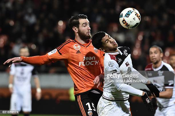 Lorient's French defender Mathieu Peybernes vies with Guingamp's French midfielder Ludovic Blas during the French L1 football match between Lorient...