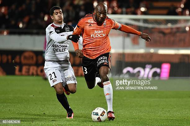 Lorient's French defender Michael Ciani vies with Guingamp's French midfielder Ludovic Blas during the French L1 football match between Lorient and...