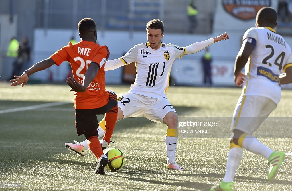 Lorient's French defender Pape Abdou Paye (L) vies with Lille's French defender Sebastien Corchia during the French L1 football match Lorient vs Lyon at the Moustoir stadium in Lorient, western France, on April 30, 2016.