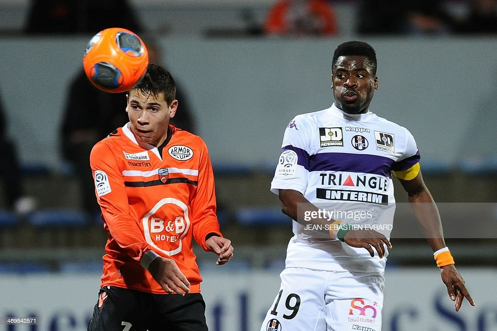 Lorient's French defender Raphael Guerreiro (L) vies with Toulouse's French defender Serge Aurier during the French L1 football match between Lorient and Toulouse on February 15, 2014 at the Moustoir stadium in Lorient, western France. AFP PHOTO / JEAN-SEBASTIEN EVRARD