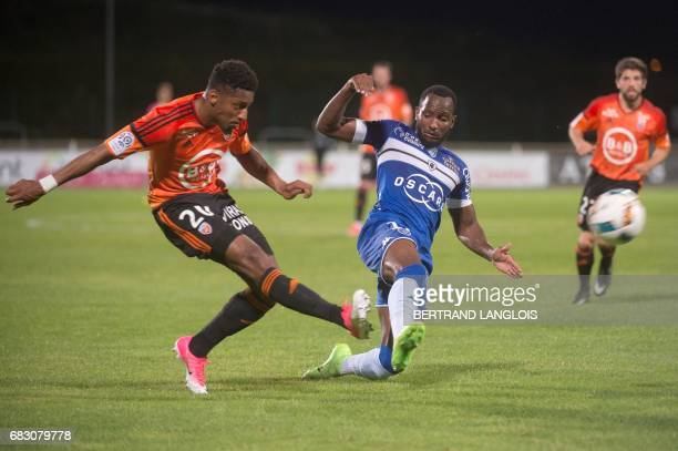 Lorient's French defender Steven Moreira vies with Bastia's French midfielder Lenny Nangis during the French L1 football match Bastia vs Lorient on...