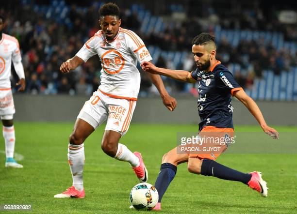 Lorient's French defender Steven Moreira vies with Montpellier's French midfielder Ryad Boudebouz during the French L1 football match between MHSC...