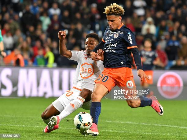 Lorient's French defender Steven Moreira vies with Montpellier's South African midfielder Keagan Dolly during the French L1 football match between...