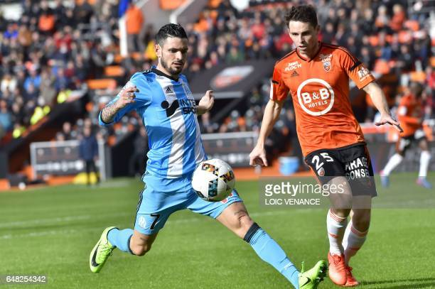 Lorient's French defender Vincent Le Goff vies with Marseille's French midfielder Remy Cabella during the French L1 football match FC Lorient vs...