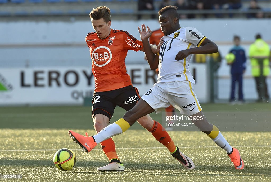 Lorient's French forward Benjamin Jeannot (L) vies with Lille's French midfielder Ibrahim Amadou during the French L1 football match Lorient vs Lille at the Moustoir stadium in Lorient, western France, on April 30, 2016.