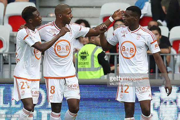 Lorient's French forward Benjamin Moukandjo celebrates after scoring a goal with team mates Lorient's French midfielder Mohamed Mara and Lorient's...