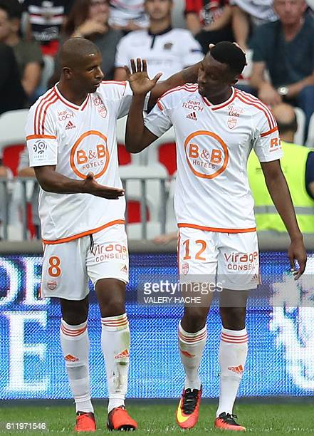 Lorient's French forward Benjamin Moukandjo celebrates after scoring a goal with team mate Lorient's Portuguese midfielder Carlos Miguel Cafu during...
