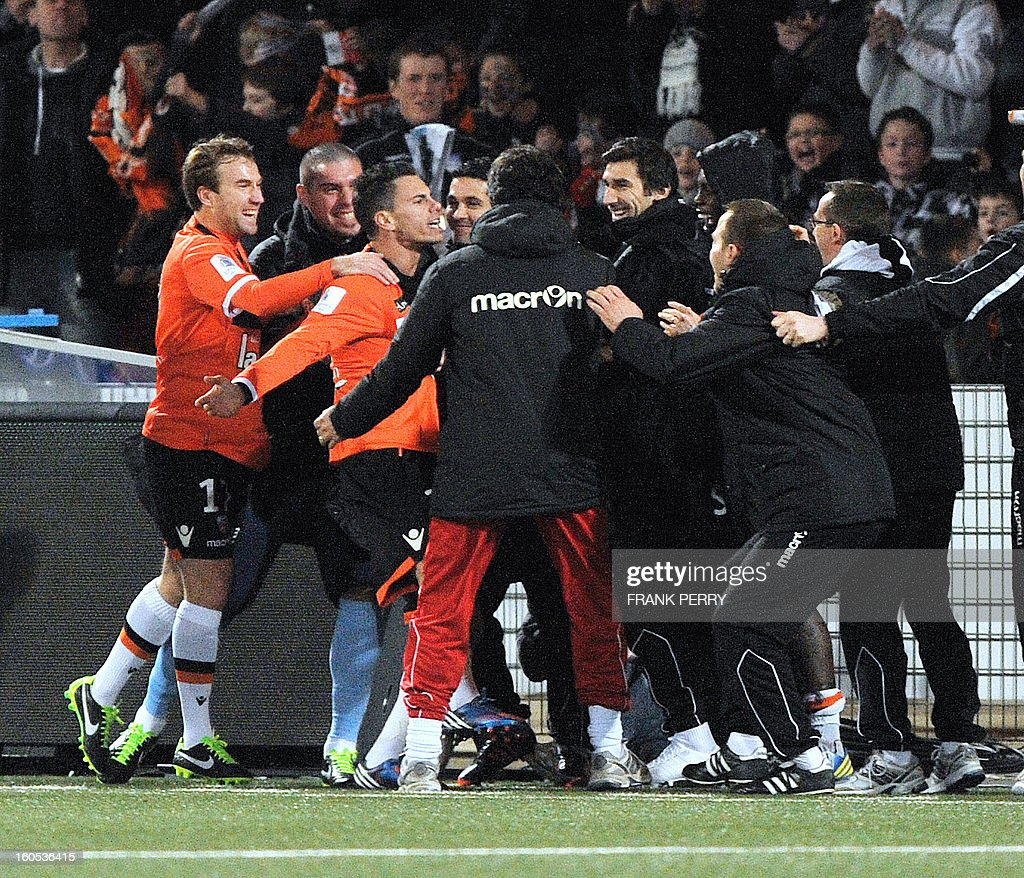 Lorient's French forward Jeremie Aliadiere (2nd-L) is congratulated by teammates after scoring a goal during the French L1 football match Lorient vs Rennes on February 2, 2013 at the Moustoir Stadium in Lorient, western France.