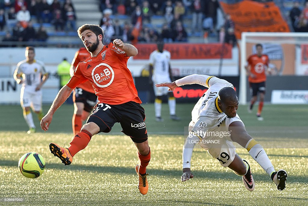 Lorient's French forward Jimmy Cabot (L) vies with Lille's French defender Djibril Sidibe during the French L1 football match Lorient vs Lyon at the Moustoir stadium in Lorient, western France, on April 30, 2016.