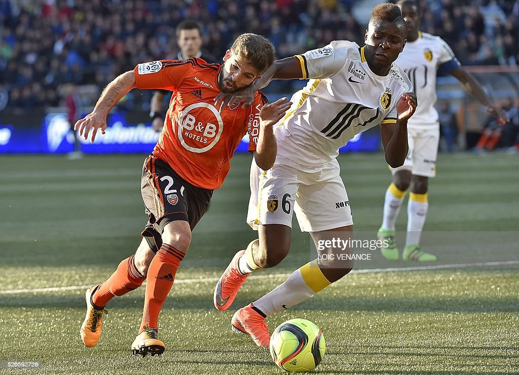 Lorient's French forward Jimmy Cabot (L) vies with Lille's French midfielder Ibrahim Amadou during the French L1 football match Lorient vs Lyon at the Moustoir stadium in Lorient, western France, on April 30, 2016.