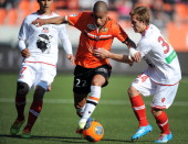 Lorient's French forward Kevin MonnetPaquet vies with Ajaccio's French defender Cedric Orengo during the French L1 football match between FC Lorient...