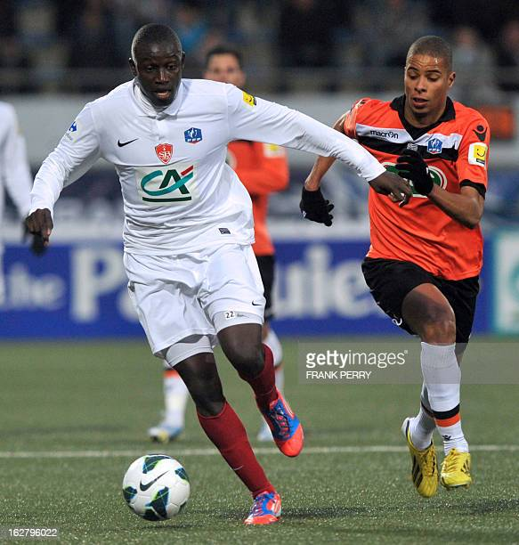 Lorient's French forward Kevin MonnetPaquet vies with Brest's French forward Kevin MonnetPaquet during the French Cup football match Lorient vs Brest...