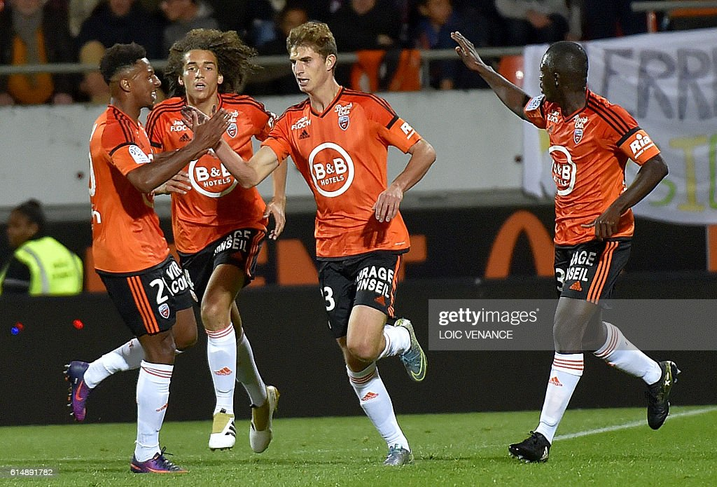 Lorient's French forward Pierre-Yves Hamel (C) celebrate after scoring a goalduring the French L1 football match Lorient vs Nantes, at the Moustoir Stadium in Lorient, western France, on October 15, 2016. / AFP / LOIC