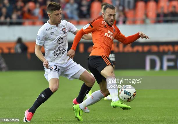 Lorient's French forward Romain Philippoteaux vies with Caen's Croatian forward Ivan Santini during the French L1 football match Lorient vs Caen at...
